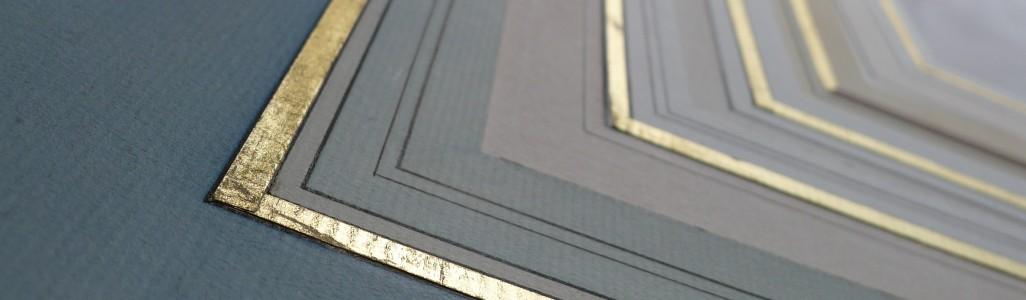 Photo couleur de différents modèles de lavis avec filets dorés et filets encre.